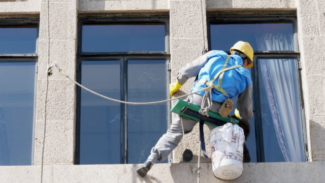 people cleans external wall in city - risk stock videos and b-roll footage