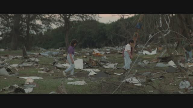 vídeos y material grabado en eventos de stock de ms, pan, people clearing debris after hurricane in rural area,  usa  - derribado