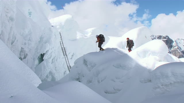 ms people climbing and walking to ladder on ice / mt. everest, nepal - ladder stock videos and b-roll footage