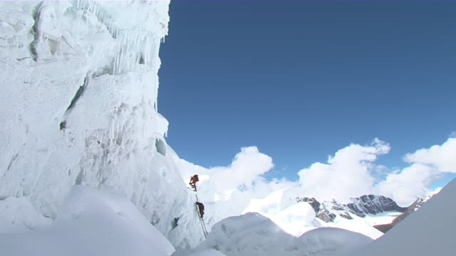 ws people climbing and walking to ladder on ice / mt. everest, nepal - ladder stock videos & royalty-free footage