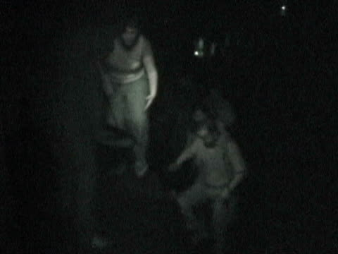 stockvideo's en b-roll-footage met people climbing onto subway platform from tunnel during citywide blackout on august 14 while woman thanks man for his help / new york, new york, usa... - 2003