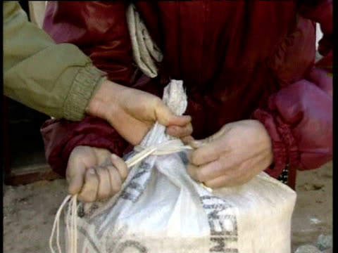People collect and queue for rice from World Food Programme emergency centre North Korea Dec 95