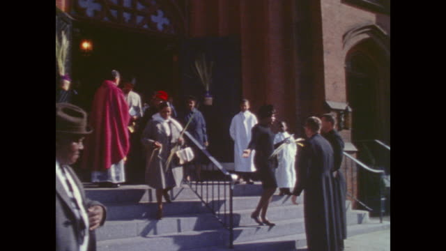people coming out of church on palm sunday in a black urban neighborhood - baltimore maryland bildbanksvideor och videomaterial från bakom kulisserna
