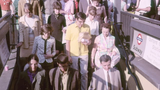 montage people commuting and walking through london, entering the subway and buying a newspaper / england, united kingdom - 1970 stock videos & royalty-free footage