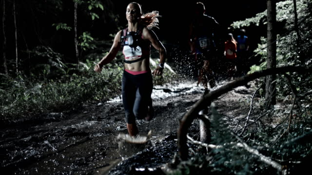 SLO MO DS People competing in a trail run at night