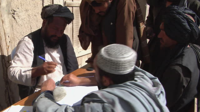 ms people completing the legal formalities / musa qala helmand province afghanistan - seal stamp stock videos and b-roll footage