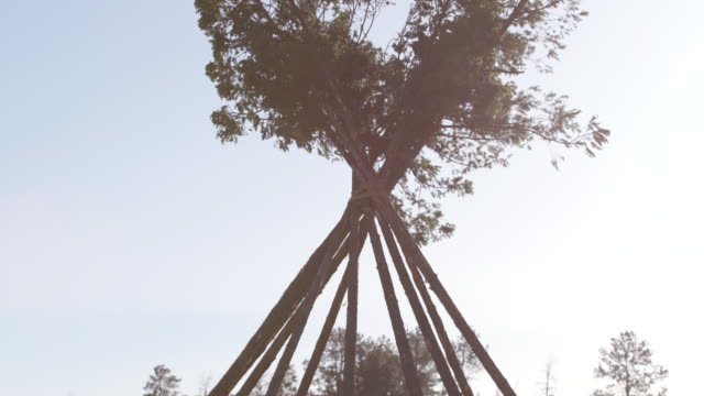 People construct teepee on Apache reservation, tilt-down