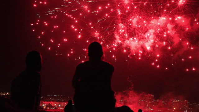 people contemplating fireworks. - romantic sky stock videos & royalty-free footage