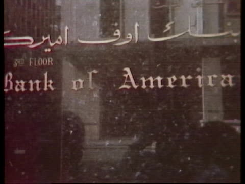 people crawl along the street in beirut to avoid being hit by gunfire during a hostage situation at the bank of america building while lebanese... - bank of america stock videos & royalty-free footage
