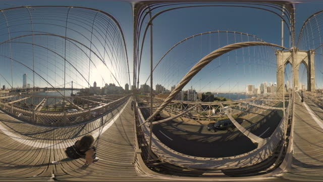 360 vr people cross the brooklyn bridge in manhattan new york usa - suspension bridge stock videos & royalty-free footage