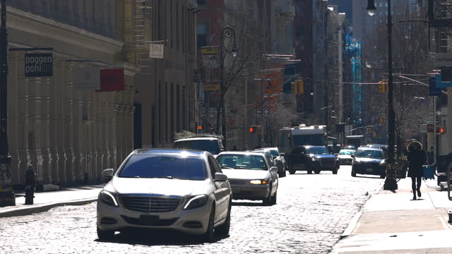 people cross the cobblestone street in soho district nyc. - loft apartment stock videos & royalty-free footage