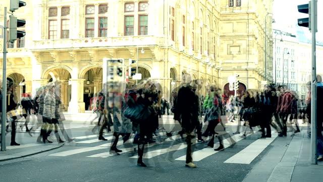 people cross the crosswalk - vienna austria stock videos & royalty-free footage
