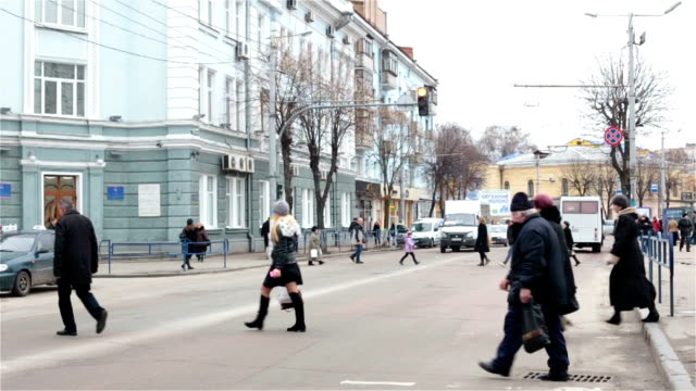 people cross the road at pedestrian crossing. - ukraine stock videos & royalty-free footage