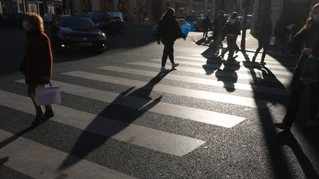 people cross the street in the department stores district on november 28, 2020 in paris, france. after almost four weeks of closure, 'non-essential'... - atmosphere filter stock videos & royalty-free footage
