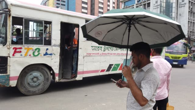 people crosses the road on busy street in dhaka - crossing stock videos & royalty-free footage