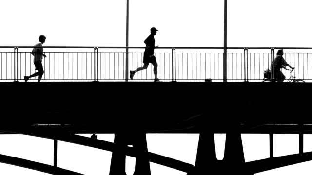 people crossing a bridge bw - black and white stock videos & royalty-free footage