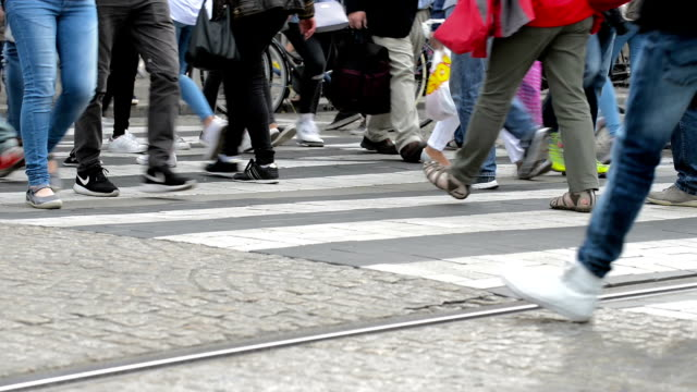 people crossing a busy city crosswalk - zebra crossing stock videos & royalty-free footage