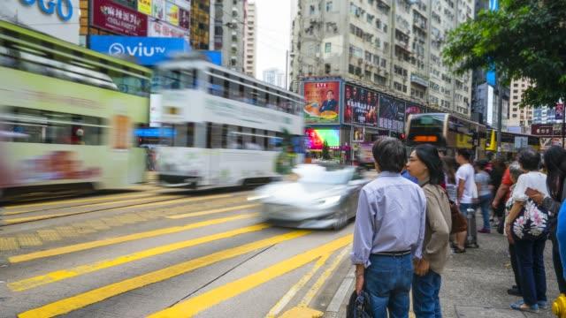 stockvideo's en b-roll-footage met people crossing a busy road junction, causeway bay, hong kong, china, asia - hong kong