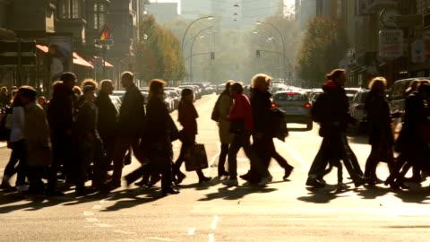 people crossing a street in berlin - pedestrian stock videos & royalty-free footage
