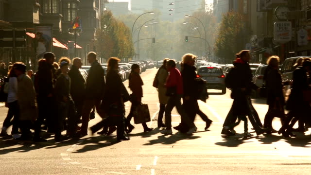 people crossing a street in berlin - pedestrian stock videos & royalty-free footage