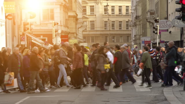 people crossing a street in vienna - austria stock videos & royalty-free footage