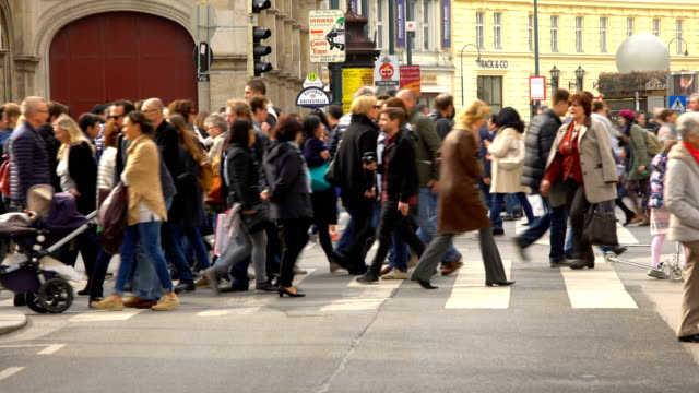 people crossing a street in vienna - zebra crossing stock videos and b-roll footage