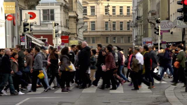 people crossing a street in vienna - crosswalk sign stock videos & royalty-free footage