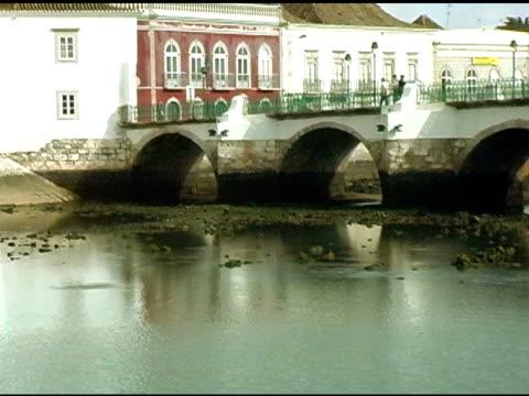 people crossing bridge in tavira portugal - circa 13th century stock videos & royalty-free footage
