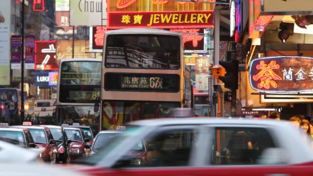 ms people crossing busy intersection / hong kong, china - butiksskylt bildbanksvideor och videomaterial från bakom kulisserna
