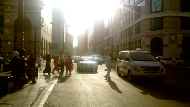 people crossing busy traffic backlit city road. - silhouette stock videos & royalty-free footage