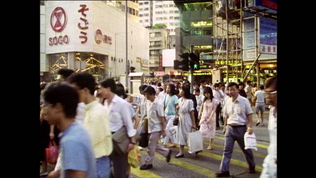 ws people crossing busy urban road in hong kong; 1989 - crossing stock videos & royalty-free footage