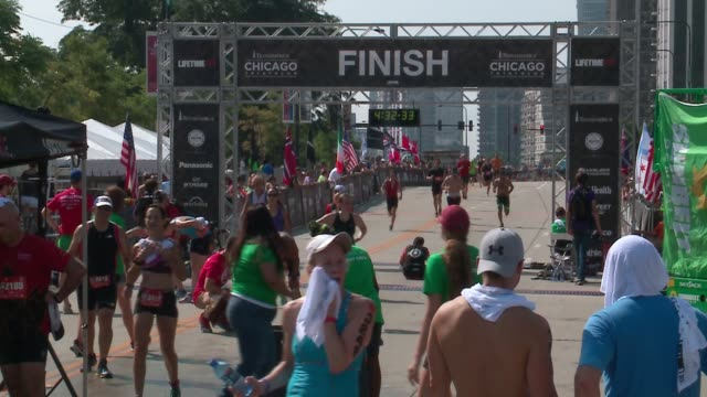 people crossing finishing line at the 2016 chicago triathlon on august 28, 2016. - triathlet stock-videos und b-roll-filmmaterial