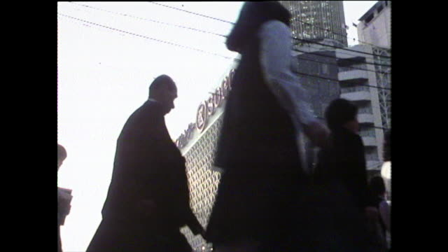 las people crossing road in hiroshima, japan; 1975 - bbc archive stock-videos und b-roll-filmmaterial