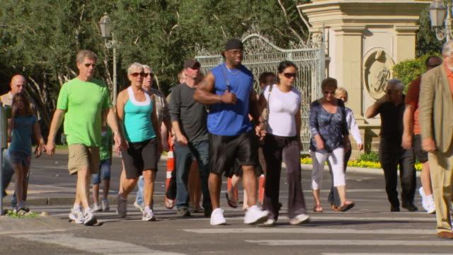 ms people crossing road / las vegars, united states - las vegas crosses stock-videos und b-roll-filmmaterial