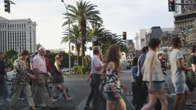 ms people crossing road / las vegas, nevada, united states - las vegas crosses stock-videos und b-roll-filmmaterial