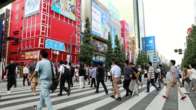 people crossing street in busy tokyo akihabara electric town - akihabara stock videos and b-roll footage