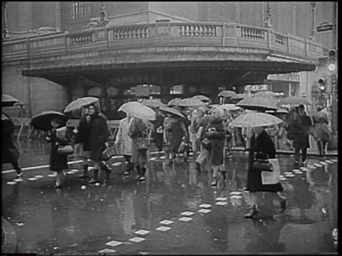 b/w 1966 people crossing street in rain / some with umbrellas / nyc / newsreel - audio available stock videos & royalty-free footage