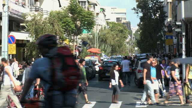 ms people crossing street on crosswalk / tel aviv, israel - tel aviv stock videos & royalty-free footage