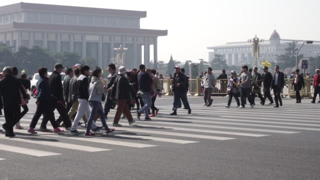 people crossing street, tiananmen square - tiananmen square stock videos and b-roll footage
