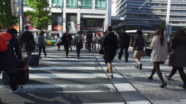 people crossing street - pedestrian crossing stock videos & royalty-free footage