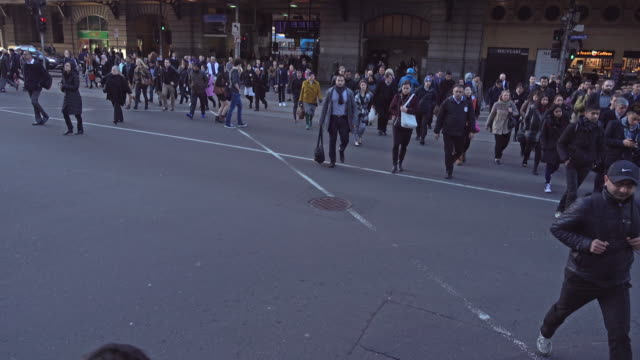 people crossing the road at melbourne, australia - public building stock videos and b-roll footage