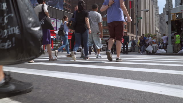 people crossing the street near penn station on a hot summer day. - midtown manhattan stock videos & royalty-free footage