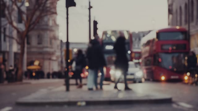 people crossing the street - british culture stock videos & royalty-free footage