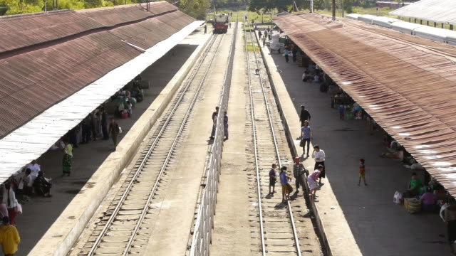 people crossing tracks at train station in mandalay, myanmar - mandalay stock videos and b-roll footage