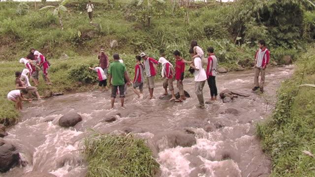 ws people crossng river / surabaya ,east java, indonesia - surabaya stock videos & royalty-free footage