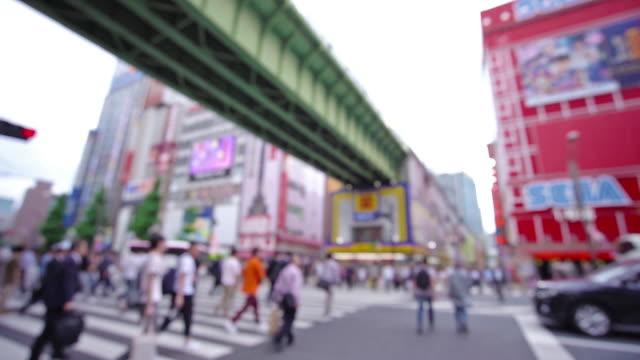 people crowd walking overpass the street intersection cross-walk ,akihabara district, tokyo, japan. - akihabara station stock videos and b-roll footage