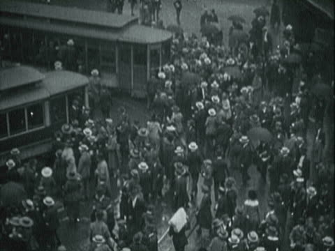 people crowded around a trolley / people trying to climb on trolley / signs for rent strikes on apartment building / people on the street with their... - 1927 stock videos & royalty-free footage
