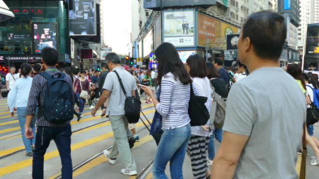 people crowded in homg kong city - zebra crossing stock videos and b-roll footage