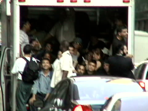 stockvideo's en b-roll-footage met people crowded into back of truck in traffic on street during citywide blackout on august 14, 2003 / new york, new york, usa / audio - 2003