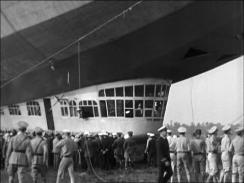 vídeos y material grabado en eventos de stock de people crowding around gondola of graf zeppelin on ground / documentary - 1928
